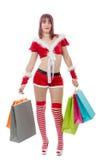 Beautiful Santa Claus woman holding shopping bags Royalty Free Stock Photo