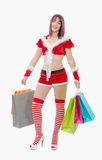 Beautiful Santa Claus woman holding shopping bags royalty free stock photography