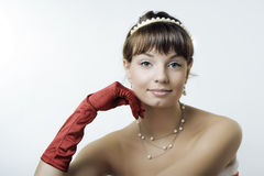 Beautiful santa girl. Images of the beautiful Santa girl on a gray background Stock Photos