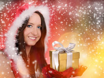 Beautiful santa girl. With falling snowflakes Stock Images