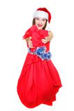 Beautiful santa girl with bag of gifts. Over white Royalty Free Stock Photography