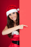 Beautiful santa girl and blank billboard Stock Images
