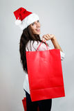 Beautiful santa girl  carrying red shopping bags. Portrait of beautiful santa girl  carrying red shopping bags Stock Photography
