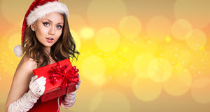 Beautiful santa girl. On the christmas background Royalty Free Stock Photo