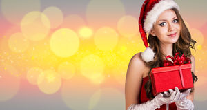 Beautiful santa girl. On the christmas background Royalty Free Stock Image