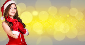 Beautiful santa girl. On the christmas background Stock Images