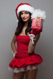 Beautiful santa girl. With Christmas and New year's gift Royalty Free Stock Image