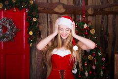 Beautiful Santa girl having fun and smiling near Royalty Free Stock Photos