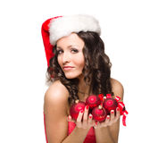 Beautiful santa girl hold baubles Royalty Free Stock Photo