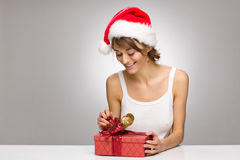 Beautiful santa girl opening giftbox Stock Photos