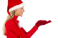 Beautiful Santa girl presenting an object. Beautiful Santa girl on white presenting/holding something; you can add your own product on hands Stock Photography