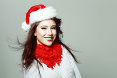 Beautiful santa girl. In red hat smiling and looking upway Stock Photography