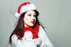 Beautiful santa girl. In red hat smiling and looking upway Stock Photo