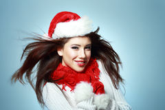 Beautiful santa girl. In red hat smiling and looking upway Stock Photos