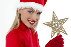 Beautiful Santa girl on white holding a Christmas. Decoration Stock Photos