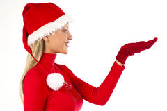 Beautiful Santa girl on white presenting/holding s. Omething; you can add your own product on hands Stock Photos