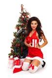 Beautiful santa helper - next to christmas tree Stock Photo
