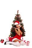 Beautiful santa helper - next to christmas tree Royalty Free Stock Photography