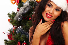 Beautiful santa helper - next to christmas tree Royalty Free Stock Image