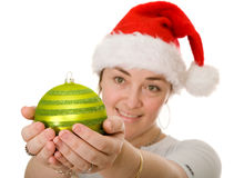 Beautiful santa holding a christmas bauble Royalty Free Stock Photography