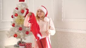 Beautiful Santa woman. Christmas shoping bag and shoping. Christmas woman dress. New year sale and Christmas discounts. Beautiful Santa woman. Christmas shoping stock video footage