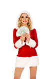 Beautiful santa woman holding a clip of polish money Royalty Free Stock Photo
