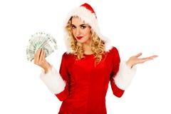 Beautiful santa woman holding a clip of polish money Royalty Free Stock Photos