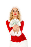 Beautiful santa woman holding a clip of polish money Royalty Free Stock Photography