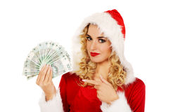Beautiful santa woman holding a clip of polish money Stock Image