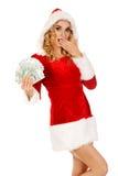Beautiful santa woman holding a clip of polish money Stock Photo