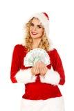 Beautiful santa woman holding a clip of polish money Royalty Free Stock Image