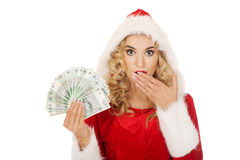 Beautiful santa woman holding a clip of polish money Stock Images
