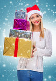 Beautiful santa woman holding gift box and credit card,snowfall background Royalty Free Stock Photography
