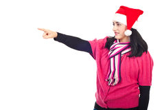 Beautiful Santa woman pointing away stock images