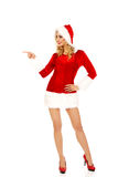 Beautiful santa woman pointing something Stock Photos