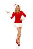 Beautiful santa woman pointing something Stock Photography