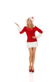 Beautiful santa woman pointing something Royalty Free Stock Image