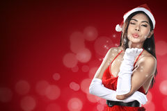 Beautiful Santa Woman. Beautiful smiling christmas santa woman wearing santa claus costume Stock Photo