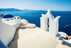 Beautiful Santorini skyline view. Blue sea, sky and white church with blue roof royalty free stock photography