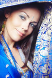 Beautiful sari. Elegant smiling lady in stylish blue wedding sari. Natural colors. Vertical photo stock photography