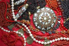 Background-east jewelry with magnificent coral necklace and pearls Royalty Free Stock Photography