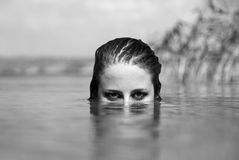 Beautiful savage girl in the river. Stock Photo