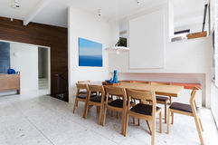 Beautiful scandinavian style interior in mid century modern Aust. Beautiful scandinavian style interior dining room in mid century modern Australian home Royalty Free Stock Images