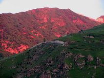 Red sunrise and mountains stock photos