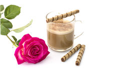 Beautiful scarlet rose and cappuccino with tubular cookies Stock Photo