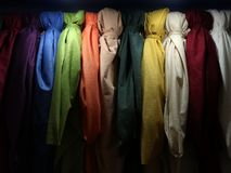 Beautiful scarves in different colors. Scarves in different colors are more in the closet stock images