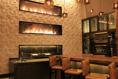 Beautiful scene of bar, with warm,inviting,fireplaces,Grand Hyatt Hotel,Denver,Colorado,2015 Stock Photography