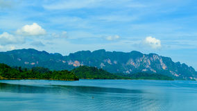 Beautiful scene Blue clear water with rock mountain. Royalty Free Stock Images
