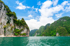 Beautiful scene of blue green clear water with rock mountain. In Ratchaprapa Dam, Suratthani, Thailand Stock Image