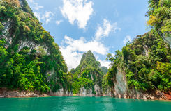 Beautiful scene of blue green clear water with rock mountain Royalty Free Stock Photography